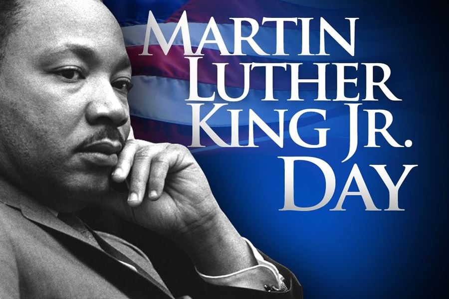 black and white photo of MLK , flag background and white lettering
